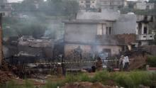 Pakistani soldiers cordon off the site where a Pakistani Army Aviation Corps aircraft crashed in Rawalpindi on July 30, 2019. - Fifteen people were killed when a small plane crashed into a residential area in the Pakistani city of Rawalpindi near the capital Islamabad, a rescue official told AFP early July 30. (Photo by AAMIR QURESHI / AFP)        (Photo credit should read AAMIR QURESHI/AFP/Getty Images)