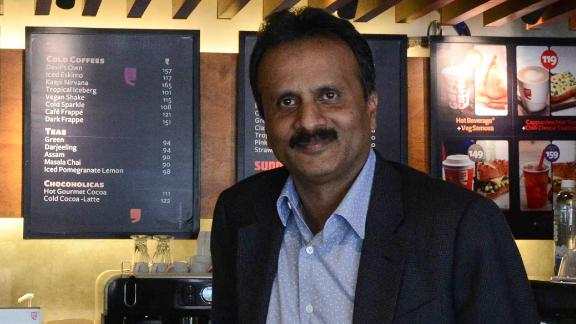 (FILES) In this file photo taken on October 8, 2015 coffee tycoon V.G. Siddhartha, owner of the Café Coffee Day chain, poses for a photograph at one of his coffeeshops in Ahmedabad. - Indian police on July 30, 2019 launched a major hunt for one of the country's richest men, coffee tycoon V.G. Siddhartha, after he went missing amid mounting fears for his safety. (Photo by SAM PANTHAKY / AFP)SAM PANTHAKY/AFP/Getty Images