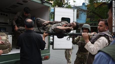A wounded Afghan man is brought on a stretcher to an Italian aid organisation hospital as Afghan security forces battled an ongoing attack by Taliban militants on a compound housing an international aid organisation in Kabul on May 8, 2019.