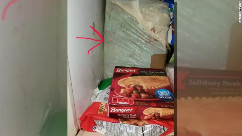 Adam Smith said this photo shows the box inside a freezer where he found a dead infant.