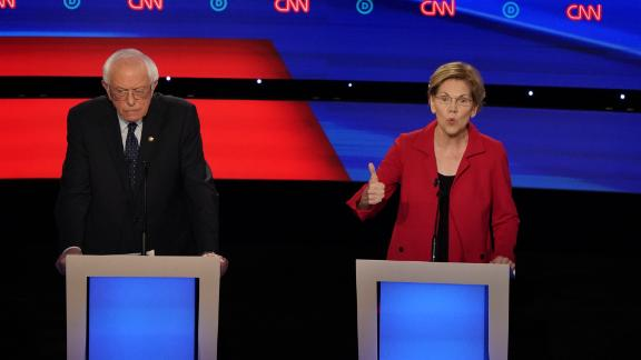 Democratic presidential hopefuls US senator from Vermont Bernie Sanders and US Senator from Massachusetts Elizabeth Warren at the Democratic presidential debate hosted by CNN at the Fox Theater in Detroit on Tuesday, July 30.