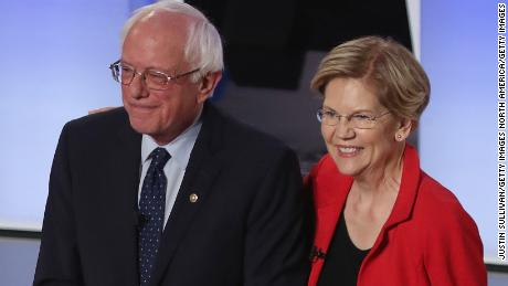 DETROIT, MICHIGAN - JULY 30: Democratic presidential candidates Sen. Bernie Sanders (I-VT) and Sen. Elizabeth Warren (D-MA) take the stage at the beginning of the Democratic Presidential Debate at the Fox Theatre July 30, 2019 in Detroit, Michigan. 20 Democratic presidential candidates were split into two groups of 10 to take part in the debate sponsored by CNN held over two nights at Detroit's Fox Theatre.  (Photo by Justin Sullivan/Getty Images)