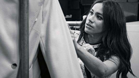 """This undated handout photo issued on July 28, 2019 by Kensington Palace shows Britain's Meghan, Duchess of Sussex, Patron of Smart Works, in the workroom of the Smart Works London office. - Prince Harry's wife Meghan will guest edit the September issue of iconic fashion magazine British Vogue, which will see her in """"candid conversation"""" with former first lady Michelle Obama. (Photo by @SussexRoyal / various sources / AFP) / XGTY / RESTRICTED TO EDITORIAL USE - MANDATORY CREDIT """"AFP PHOTO / @SUSSEXROYAL"""" - NO MARKETING NO ADVERTISING CAMPAIGNS - NO COMMERCIAL USE - NO THIRD PARTY SALES - RESTRICTED TO SUBSCRIPTION USE - NO CROPPING OR MODIFICATION - DISTRIBUTED AS A SERVICE TO CLIENTS /         (Photo credit should read @SUSSEXROYAL/AFP/Getty Images)"""