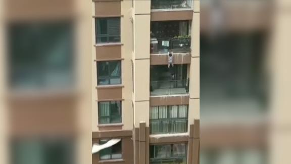 A 3-year-old boy fell from a six-storey balcony in Chongqing, China, and was saved by the crowd below.
