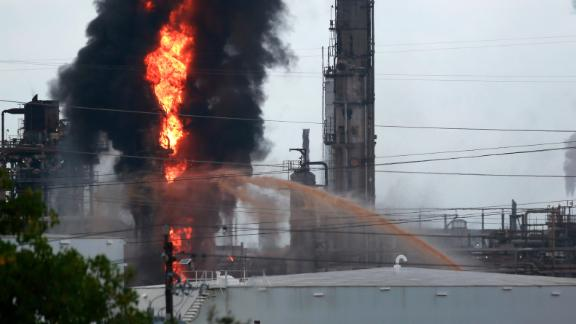 Flames and smoke rise from the ExxonMobil complex in Baytown, Texas.