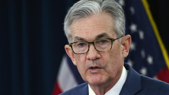 """US Federal Reserve Chairman Jerome Powell speaks during a press conference after a Federal Open Market Committee meeting in Washington, DC on July 31, 2019. - The US Federal Reserve cut the benchmark lending rate on Wednesday for the first time in more than a decade, moving to stimulate the economy after a year of sustained pressure from President Donald Trump. The target for the federal funds rate is now 2.0-2.25 percent, 25 basis points lower, and the central bank vowed to """"act as appropriate to sustain the expansion."""" (Photo by ANDREW CABALLERO-REYNOLDS / AFP)"""