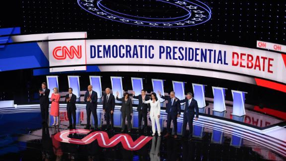 Democratic presidential candidates wave from the stage ahead of the second round of the second Democratic primary debate of the 2020 presidential campaign season hosted by CNN at the Fox Theatre in Detroit, Michigan on July 31, 2019.