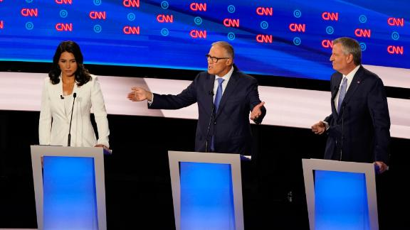"Inslee participates in the CNN Democratic debates in July 2019. ""The time is up,"" he said, referring to climate change. ""Our house is on fire."""