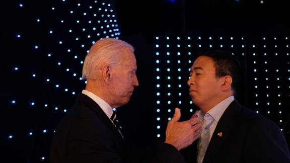 Yang and former Vice President Joe Biden talk backstage at the CNN Democratic debates in July 2019.