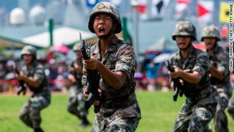Soldiers of the Peoples' Liberation Army (PLA) perform drills during a demonstration at an open day at the Ngong Shuen Chau Barracks in Hong Kong on June 30.