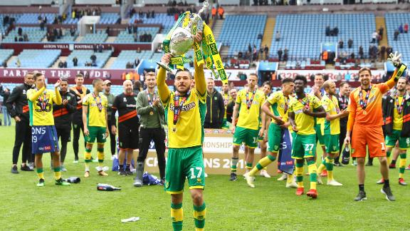 Emi Buendia of Norwich City lifts the Championship trophy in celebration.