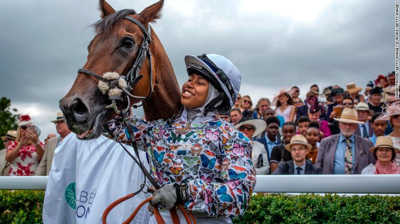 Mellah celebrates after winning with her horse 'Haverland' in the charity race, the Magnolia Cup.