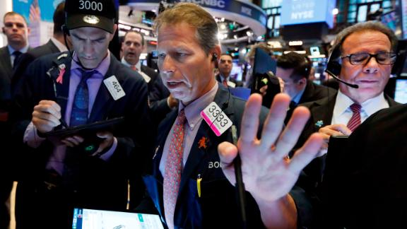 Trader Robert Charmak, center, works on the floor of the New York Stock Exchange, Wednesday, July 31, 2019. Stocks are opening slightly higher on Wall Street led by gains in Apple and other technology companies. (AP Photo/Richard Drew)
