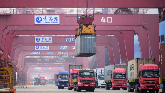 QINGDAO, CHINA - JUNE 28: A shipping container is unloaded onto a truck at Qingdao Port on June 28, 2019 in Qingdao, Shandong Province of China. China