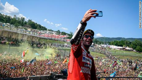 Danilo Petrucci takes a celebration selfie on the Mugello Podium.