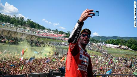 Danilo Petrucci takes a celebration selfie on the Mugello Podium