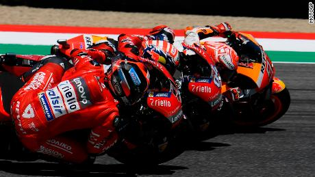 Petrucci dips under Dovizioso and Marquez to take final lap lead.