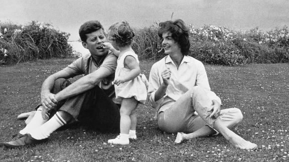 John and Jackie Kennedy play with their daughter, Caroline, in 1959. He was elected President one year later.