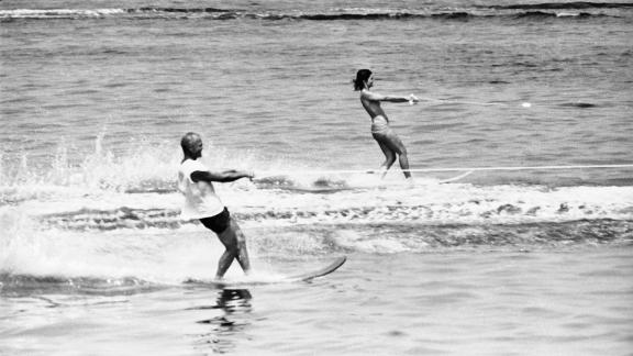 First lady Jackie Kennedy and astronaut John Glenn do a little water skiing in Nantucket Sound in 1962.
