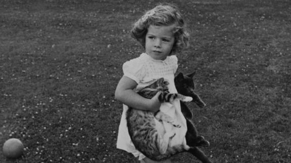 Caroline holds cats in the gardens of Hyannis Port in 1961.