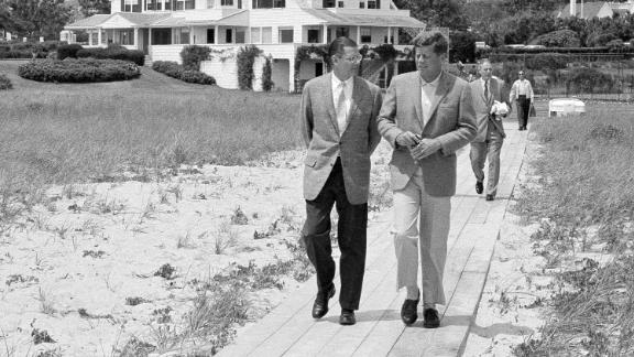 President Kennedy, right, walks with Defense Secretary Robert McNamara in 1961.