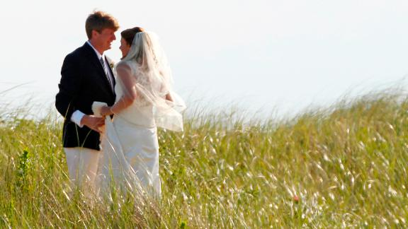 Former US Rep. Patrick Kennedy, one of Ted's sons, walks with his wife, Amy, after their wedding in Hyannis Port in 2011.