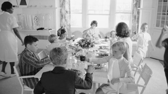 Ethel Kennedy sits with various Kennedy children in 1963, when the family was celebrating the christening of Bobby's son Chris.