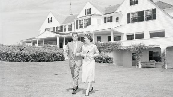 US Sen. John F. Kennedy is joined by his fiancee, Jacqueline Bouvier, at the Kennedy compound in Hyannis Port, Massachusetts, in 1953. They had just announced their engagement.