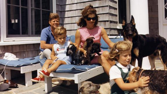 John and Jackie, joined by Caroline and John Jr., play with dogs in 1963.