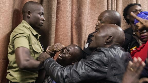 After a plastic bottle was thrown at at the magistrate, police officials clashed with spectators in the courtroom.