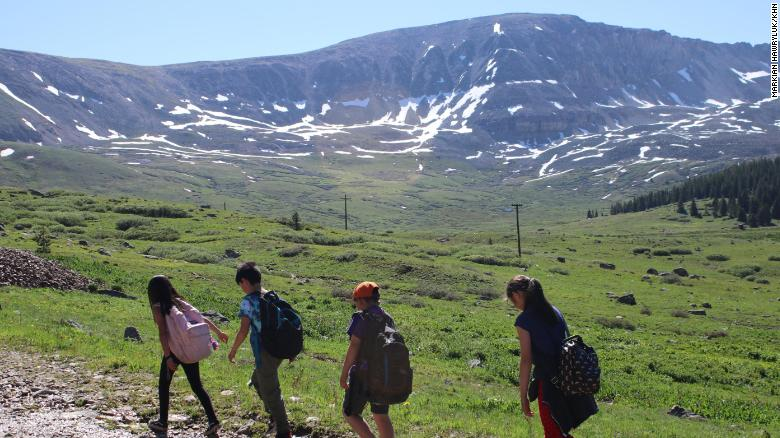 A group of 8- and 9-year-olds trudges up a mountain as part of a program through Get Outdoors Leadville!