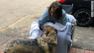 A woman lost her hands and legs to an infection from puppy kisses