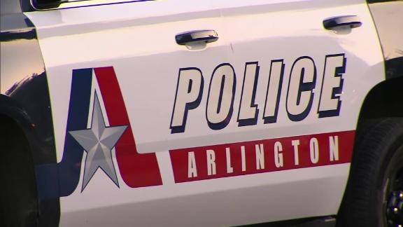 An Arlington, Texas, police officer shooting at a dog shot and killed a woman instead, police said.