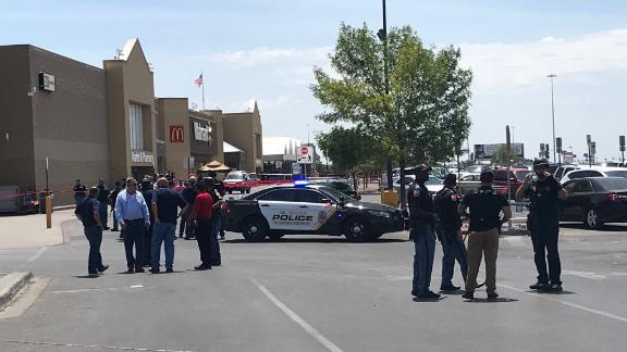 Police gather outside the Walmart at Cielo Vista Mall.