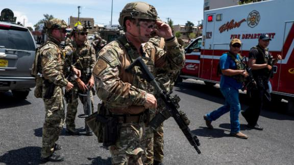 "Law enforcement agencies respond to an active shooter at a Wal-Mart near Cielo Vista Mall in El Paso, Texas, Saturday, Aug. 3, 2019. - Police said there may be more than one suspect involved in an active shooter situation Saturday in El Paso, Texas. City police said on Twitter they had received ""multi reports of multipe shooters."" There was no immediate word on casualties. (Photo by Joel Angel JUAREZ / AFP)        (Photo credit should read JOEL ANGEL JUAREZ/AFP/Getty Images)"
