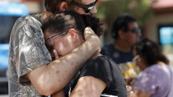 Kendall Long comforts Kianna Long, who was in the freezer section of the El Paso Walmart during the shooting.