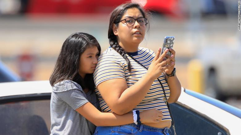 A girl reacts after a mass shooting at a Walmart in El Paso, Texas, U.S. August 3, 2019.