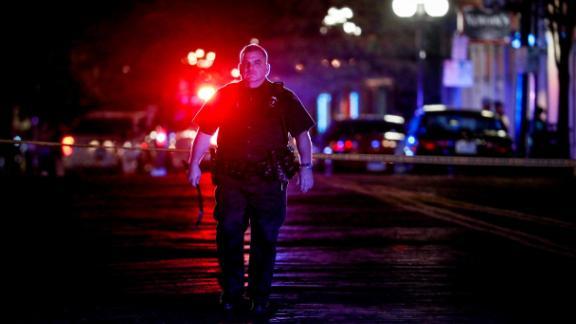 Authorities work at the scene in Dayton.