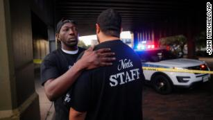 Witnesses comfort one another at the scene of a mass shooting in Dayton, Ohio.
