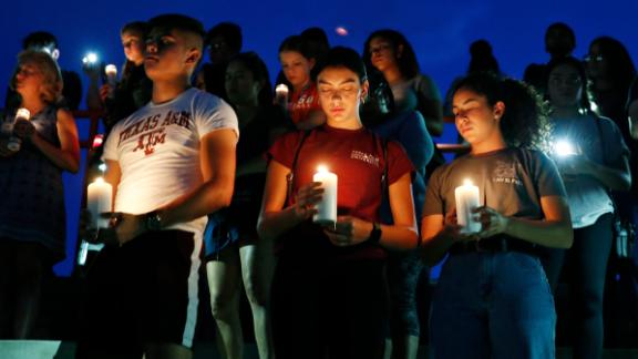 From left, Samuel Lerma, Arzetta Hodges and Desiree Quintanar attend a vigil for victims of the deadly shooting that occurred earlier in the day at a shopping center Saturday, Aug. 3, 2019, in El Paso, Texas. (AP Photo/John Locher)
