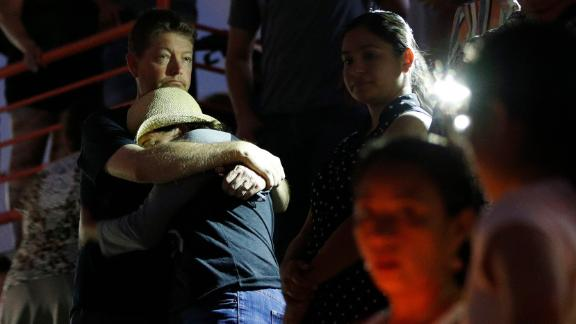 People embrace during a vigil for victims of the shooting Saturday, August 3, 2019, in El Paso, Texas.