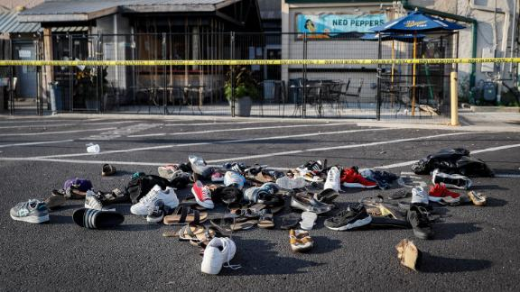 Shoes, hats and other articles of clothing are piled together outside the Ned Peppers bar in Dayton on Sunday.