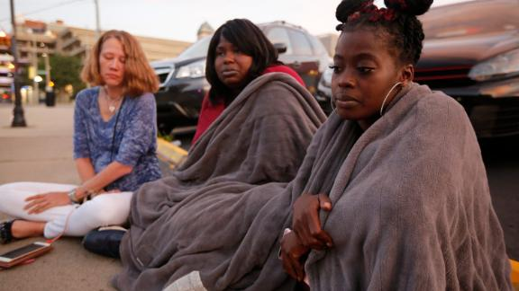 From left, Tiffany McConnell, Tanycia Leonard and Nikita Papillion recall their night in Dayton.