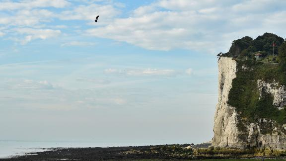 """Franky Zapata on his jet-powered """"flyboard"""" lands at St. Margaret's Bay in Dover."""