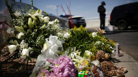 Flowers left by mourners lie near the site of the shooting in El Paso.