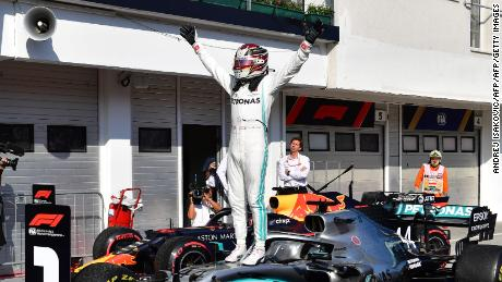Lewis Hamilton celebrates his thrilling victory at the Hungarian Grand Prix.