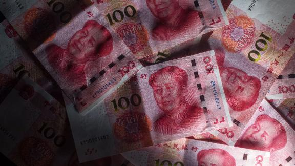 The Chinese yuan slid to a record low Monday on the offshore market.