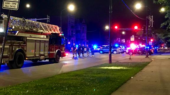 Chicago Fire Department paramedics respond to a shooting in the 2900 block of West Roosevelt Road, when seven people were wounded by gunfire around 1:20 a.m. in Douglas Park in Chicago, Ill.