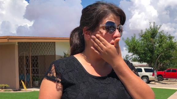 Erika Contreras stands outside the MacArthur School, the designated reunification center, in the aftermath of the El Paso shooting.