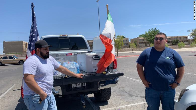 Briyan Estrada and Gabriel Gonzalez spent hours Sunday handling ice-cold water bottles to fellow El Pasoans.